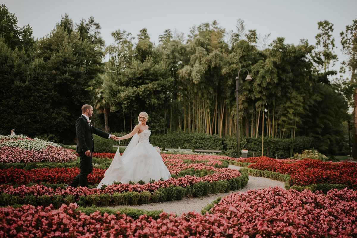 A wedding couple in the flower garden