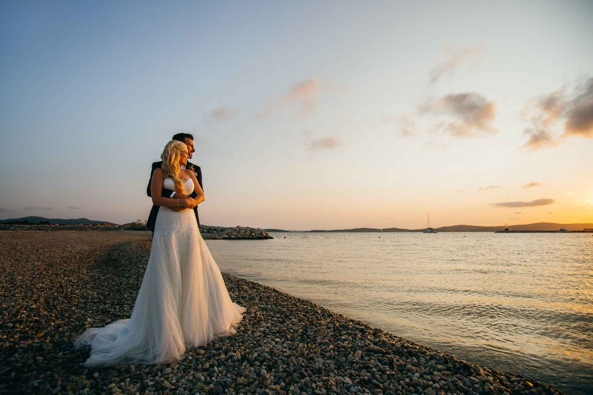 A wedding couple watching the sunset